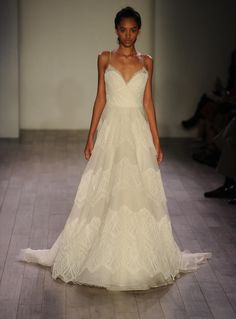 Jim Hjelm ivory lace and organza wedding dress with sweetheart neckline from Fall 2016 |  https://www.theknot.com/content/jim-hjelm-wedding-dresses-bridal-fashion-week-fall-2016