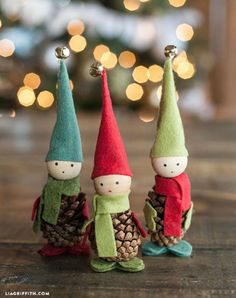 These cute little fellas from Lia Griffith are a whimsical addition to a holiday vignette on your mantel. Make the hat, scarf and mittens out of felt and head with a wooden bead. Then hot glue them onto the pine cone.