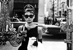 "Breakfast at Tiffany's (1961): Among the most romantic of all sequences filmed in New York City are those in Blake Edwards' screen adaptation of Truman Capote's tale, ""Breakfast at Tiffany's"". The film's opening sequence showed Audrey Hepburn as Holly Golightly, still wearing a glamorous evening dress from the night before, staring dreamily into Tiffany's gem-filled window as she consumes a breakfast of coffee and a Danish pastry. The scene took place at the corner of 5th Avenue and 57th Street."