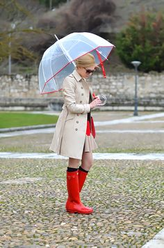 love the trench + cheery red rain boots