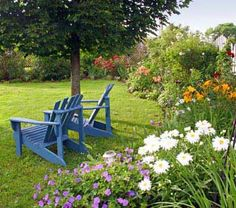 backyard garden-love the blue chairs. Hard to find pretty blues
