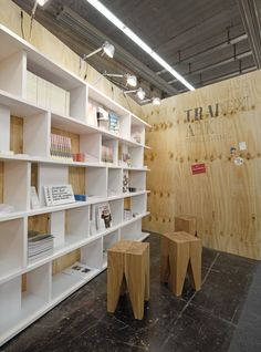 Exhibition Design at Frankfurt Book Fair for design book publisher Trademark Publishing by PHILIPP MAINZER featuring e15 stool BACKENZAHN™ (2009). Photo: Ingmar Kurth. #oak #shelf