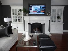 Installed new zero clearance fireplace unit, framed wall enclosure floor to ceiling with recessed TV niche built in, built custom mantle and flanking cabinetry Above Fireplace Ideas, Wall Units With Fireplace, Fireplace Redo, Fireplace Built Ins, Style At Home, Zero Clearance Fireplace, Living Room Tv, Living Spaces, Built In Cabinets
