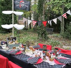 pirate party - love the bunting between masts at the end of each table!