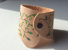 A personal favorite from my Etsy shop https://www.etsy.com/listing/496577227/leather-cuff-freehand-vines