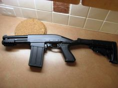 My guess is that this is one of the Chinese clones of the Remington 870. They make them with and without magazines. The stock is a Blackhawk Knoxx recoil-reducing stock. The magazine allows a shorter barrel without sacrificing ammunition capacity. I think a broomstick foregrip would be needed to pump the action. The photo is …   Read More …