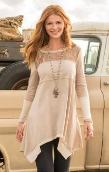 A soft knit, lace yoke tunic that conveys an effortless air of charm.