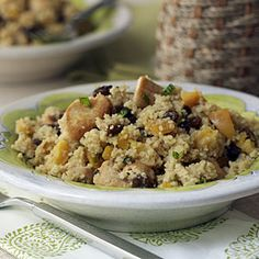 Chicken-Mint Couscous with Raisins and Apricots. Ingredients: 2 1/2 cups water; 8 peppermint tea bags; 1/2 cup chopped dried apricots; 1 cup uncooked couscous; 1 pound boneless, skinless chicken breasts or thighs; 2 tablespoons olive oil; 1/2 cup raisins; 2 tablespoons butter; 2 teaspoons salt; 1/4 teaspoon ground cinnamon; 2 tablespoons chopped fresh mint (optional).
