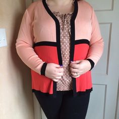 Colorblock cardigan Bright cardigan! It's peach and coral with a black trim. Open in the front. No tag, but it's a 2x. The blouse is also for sale. I'm modeling as 18/20, 40 f/g, 5'7. Misook Sweaters Cardigans