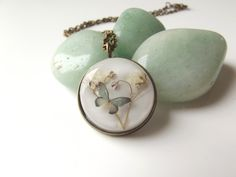 Tiny summer butterfly and baby's breath pendant £16.00