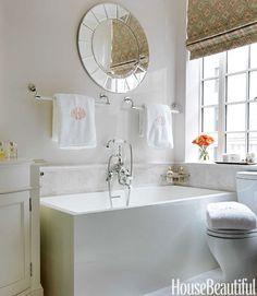 Put towel racks above the tub for a more convenient set-up.