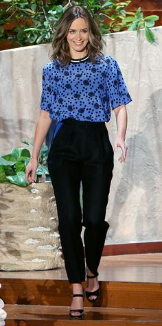 Emily Blunt charmed on The Ellen Degeneres Show in a blue polka dot Emanuel Ungaro blouse tucked into black high-waisted trousers, with black patent Rupert Sanderson sandals.