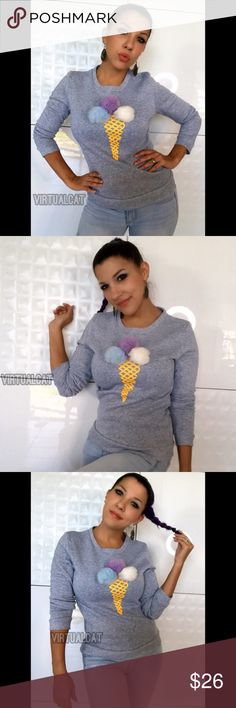 Pom Pom Ice Cream Cone Sweater So cute, you could just eat it up!!! Totally adorable ice cream cone scoop neck sweater in a deep heather gray base. Includes 3 removable tri-colored pom-poms which pose as fun scoops of ice cream. Wear with shorts on a cool day or with jeans in the fall. Or...for a cute spin on edge-style, wear this sweater under a fitted leather bomber jacket in winter months. Don't forget to let your pom-poms show! Sweaters Crew & Scoop Necks