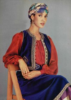 L'officiel magazine 1976, Yves Saint Laurent velvet outfit mid 70s ethnic boho look blue velvet skirt vest soutache red peasant blouse floral turban hat belt dangle earrings cobalt