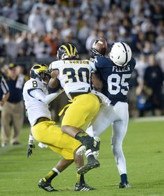 PENN STATE – FOOTBALL 2013 – Penn State vs Michigan on Homecoming, October 12, 2013. FELDER grabs pass deflected by Michigan defender.