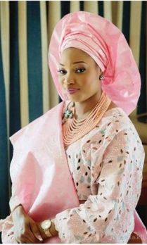 Nigerian Yoruba bride in Pale pink/silver attire with pink beads with silver brooch jewelry