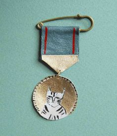 This painted leather medal really inspires me.  (Medal from artist Datter on Etsy.)