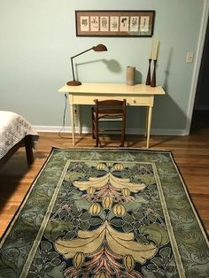 Guildcraft Carpets ~ Lily & Vine 1 (Summer Colors) green and blue Charles Voysey wool rug looking beautiful in a simple but well done bedroom.