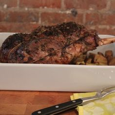 This Rosemary and Garlic Roast Leg of Lamb is a great recipe for a crowd - I personally don't care for lamb - but this looks pretty yummy Food Network Recipes, Real Food Recipes, Great Recipes, Dinner Recipes, Cooking Recipes, Favorite Recipes, Dinner Ideas, Roast Lamb Leg, Lamb Dishes