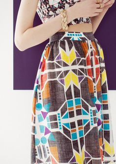 Other Stories|Alyson Fox. with HM. bold geometric print, gathered skirt. gold braided bracelet.