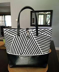 Black and White Canvas and Leather Tote perfect for anytime/anywhere. Running errands, work, collage, traveling, road trips, volunteering, beach, farmers market... everywhere!