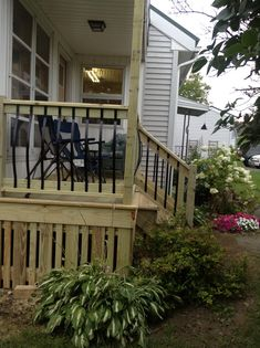 Curved black balusters and a varied width deck skirt smarten up this design and help keep animals from crawling under your deck.