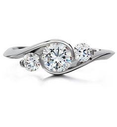 LOVE this three stone engagement ring
