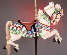 SORO Adoptive family: Soroptomists International My story: This pony is modeled after an old-fashioned Stein and Goldstein carousel horse. It is a fanciful pony, with green streamers and a light-colored coat.