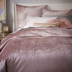 "I can't help but think of the line ""What is this, velvet?"" From Coming To America. And yet it is wondrously, plushly, blushly pink and sumptuous to even cast a gaze upon. This is a bed that would hold you at night. Washed Luster Velvet Duvet Cover + Shams #westelm"