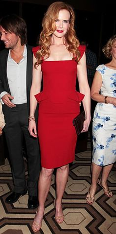 Look of the Day › July 14, 2011 WHAT SHE WORE Kidman took in a screening of Snow Flower and the Secret Fan in a knee-length Elie Saab peplum dress paired with a ruby Cathy Waterman cuff, bordeaux L'Wren Scott clutch and strappy Jimmy Choo sandals.