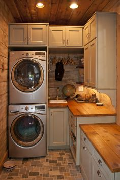 Even a simple space, such as this utility room, exudes creative (and comfortable, if you're a cat) character. Custom cabinets, reclaimed barn boards, whimsical floor tile, and functional use of space can make the chore of washing and folding laundry more enjoyable.