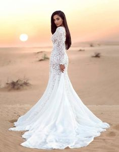 Beautiful wedding dress with a trail  Dubai Desert Sunrise Photoshoot  Photography by Oleander  Sylwia Romaniuk Fashion Designer