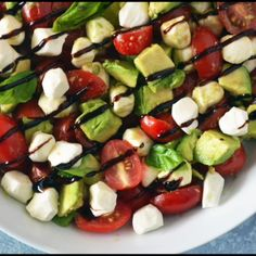 The traditional Caprese salad of tomatoes, fresh mozzarella and basil gets an upgrade with the addition of avocado and a balsamic glaze in this recipe. Tomato Basil Salad, Tomato Mozzarella Salad, Tomate Mozzarella, Salade Caprese, Caprese Salad Recipe, Avocado Salad Recipes, Summer Salad Recipes, Summer Salads, Cookout Food