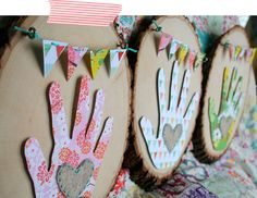 wooden plaques with handprints and garlands (so so cute) awesome gift idea (for myself - ha!)