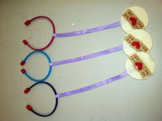 Doc mcstuffins DIY stethoscope. Head band, felt, ribbon & hot glue.