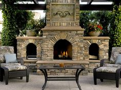 A fireplace of El Dorado stone warms this outdoor sitting area.