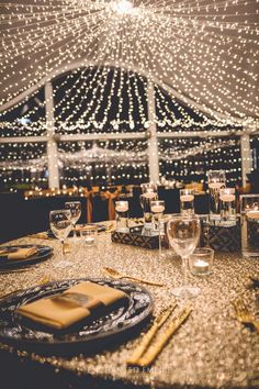 This Great Gatsby style was based on the 2013 movie hit directed by Baz Luhrmann incorporating the bold party atmosphere that Jay Gatsby was renowned for. Setting the scene with an abundant cascading canopy of fairylights and sparkling linen dressed with bold art deco prints, charger plates and our stunning gold cutlery. Wedding reception ideas. Great Gatsby. See the full film on our YouTube channel: https://youtu.be/iYtCL-RsCZY