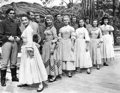 Tommy Rall, Norma Doggett, Matt Mattox, Russ Tamblyn, Betty Carr, Jacques D'Amboise, Nancy Kilgas, Marc Platt, Virginia Gibson,  Jeff Richards, Ruta Kilmonis, and Julie Newmar  // Seven Brides for Seven Brothers (1954)