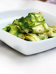 a new twist on making zucchini... shaved!    4 medium zucchini-about 4 cups  2 garlic cloves--peeled and smashed  2 Tbs olive oil  1/2 tsp dry thyme  zest from 1 lemon  juice of 1/2 lemon  salt and pepper to taste