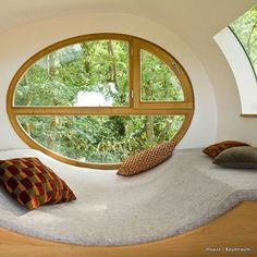 A special feature that accentuates the experience of this German treehouse is its rounded shape. The elliptical window with curved lounging area seems like the perfect spot to lose yourself in the trees...