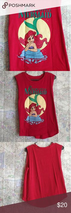 Disney's Little Mermaid Hi Low Muscle Tee Ariel From Disney's movie The Little Mermaid, this vibrant top is great to wear over jeans or shorts to create a casual look. It is Juniors sized 7-9 but can fit bigger sizes. Graphic print is in excellent condition.  Measurements when laying flat: ~19 inches across the chest (armpit to armpit seam) ~23 1/2 inches top to bottom center lenght in the front. Add an inch and a half approx for the back.  Excellent used condition! I can bundle this with…