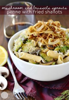 Mushroom and Brussels Sprouts Penne with Crispy Fried Shallots is a delicious meatless main with a tasty oniony crunch! #glutenfree | iowagirleats.com