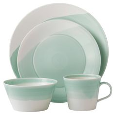 Bring stylish appeal to your dining table or breakfast nook with this lovely dinnerware set, crafted of porcelain and featuring a white and green finish.