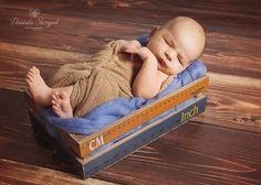 Newborn baby boy in the creative box