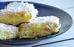 "Lemon Squares 1 box angel food cake mix 21-oz. can lemon pie filling 1/8 C powder sugar Mix cake mix & pie filling together. Pour into a lightly greased 9"" x 13"" baking pan. Bake 350 degrees for 30 min. cool. Sprinkle powder sugar over top."