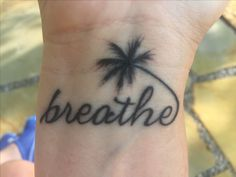 Breathe palm tree tattoo