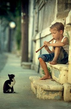 cat & boy... Nothing quite as precious...  kittie, a boy and his music