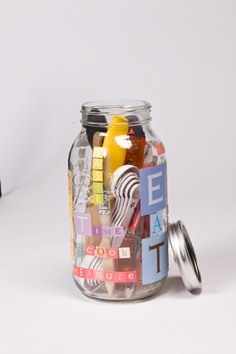 DIY decorative kitchen jars...Pack up small kitchen utensils for easy storage and access.