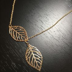 Unique Gold Double Leaf Pendant Necklace Brand New & Comes Packaged! Perfect for all events, occasions and even as gifts! ALL ORDERS ARE SHIPPED THE SAME DAY - Jewelry Necklaces