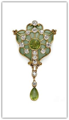 Marcus & Co. | Art Nouveau Plique-a-Jour Enamel, Peridot, and Diamond Brooch, Marcus & Co., centering a circular-cut peridot within a shaped plique-a-jour enamel frame with old European-cut diamonds and suspending a drop.